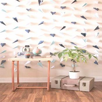 A paper airplane backdrop is perfect for your wedding ceremony, an upcoming party, as a photo booth